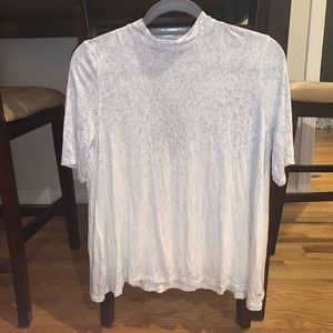 white flowy, spotted shirt